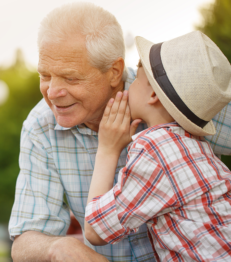 Grandchild telling Grandpa a secret