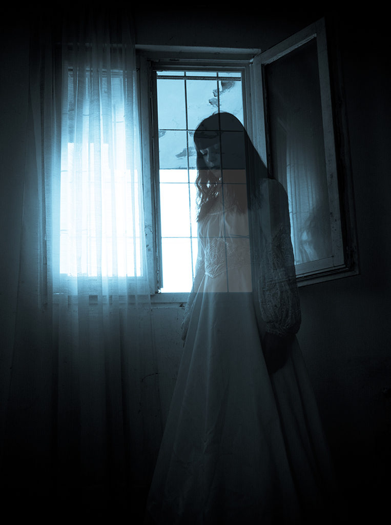 Ghostly woman in front of a window